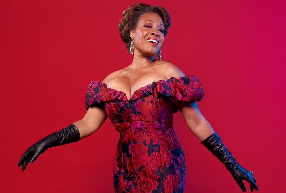 SKY HIGH:  Soprano Janinah Burnett uses her NYC balcony as a launch pad to share her soaring voice